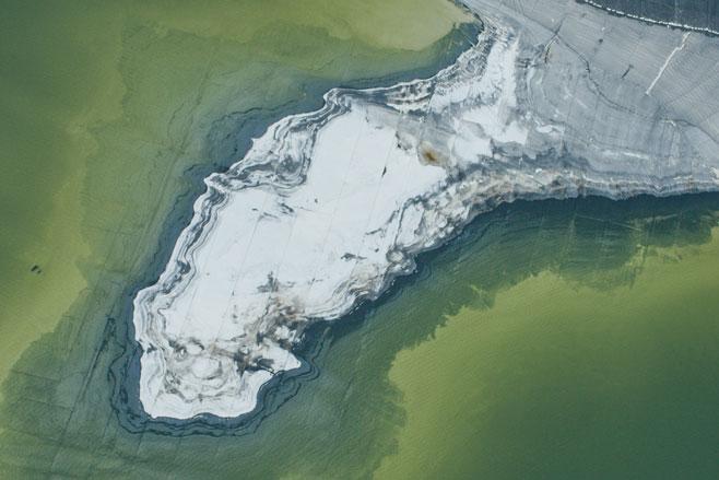 Aerial view of phosphor tailing ponds near Lakeland, Florida Credit: Photo courtesy of Anthropocene Films Inc. © 2018